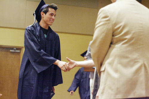 Christian Dominguez receives his diploma during his graduation ceremony at United Methodist Church in Glendale on Thursday, July 19, 2012.