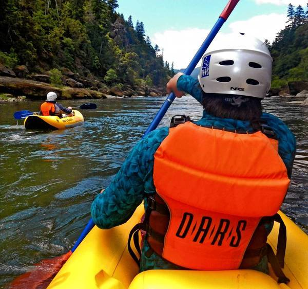 "A paddler maneuvers his ""rubber duckie"" on Rogue River in Oregon."