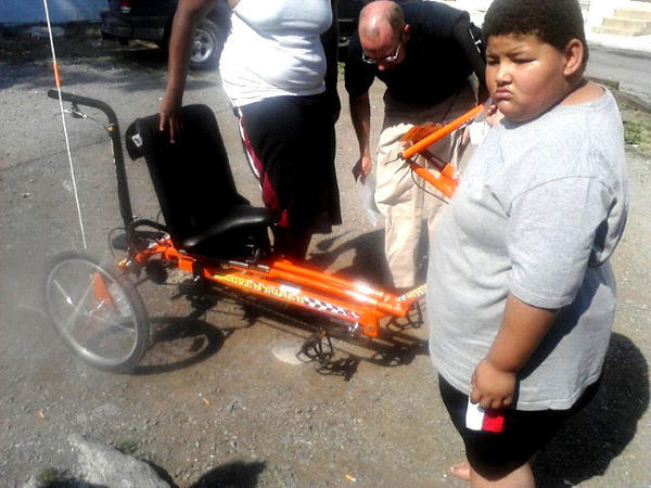 This photo shows the missing tricycle and Ethan Paugh.