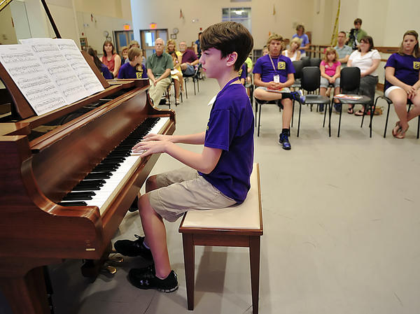 Connor Buckley performs a piano solo Thursday at the Barbara Ingram School for the Arts Summer Arts Academy after participating in a one week piano camp.