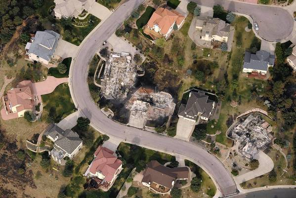 An aerial photo shows how the Waldo Canyon fire destroyed some homes but skipped past others in the Mountain Shadows subdivision area of Colorado Springs, Colo.
