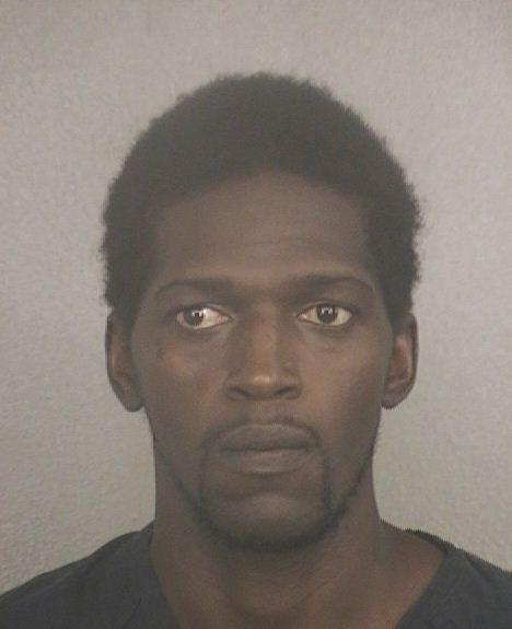 Eric Jackson held on burglary warrant while police investigate the possibility of child abuse against his infant son.