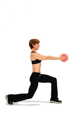 Stand with your feet together holding a medicine ball in front of your chest with straight arms. Lunge back with your right leg so your left ankle is directly below your left knee and your right knee is bent close to the floor.