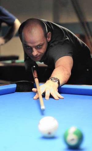 Darren Appleton, a native of Pontefract, England, who now lives in the Lehigh Valley, lines up a shot at Buzzy's Billiards in Allentown. Appleton is the world's top ranked billiards player.