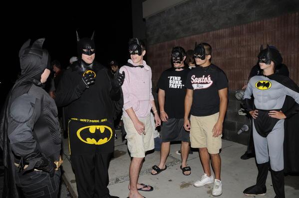 "Joshua Stine, Jared Gary, Cody Boyd, Noah McQuillan, Mike Heider and Savanna Mitchell await the opening of ""The Dark Knight Rises"" Thursday night at Richland Cinemas. Nearly 700 people attended the film's midnight screening."