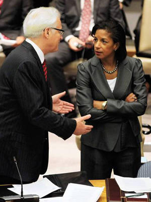 At the United Nations, Russian Ambassador Vitaly Churkin speaks to U.S. counterpart Susan Rice before a vote on a U.N. Security Council resolution on Syria. Russia, along with China, vetoed the sanctions resolution.