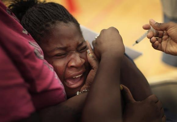 "Tiana Williams, 13, receives a vaccination against human papillomavirus in <a class=""taxInlineTagLink"" id=""PLGEO100101200000000"" title=""Washington, DC"" href=""/topic/us/washington-dc-PLGEO100101200000000.topic"">Washington, D.C.</a> Illinois falls is below the national average in vaccination rates for HPV, which causes cervical <a class=""taxInlineTagLink"" id=""HEDAI0000010"" title=""Cancer"" href=""/topic/health/diseases-illnesses/cancer-HEDAI0000010.topic"">cancer</a>."