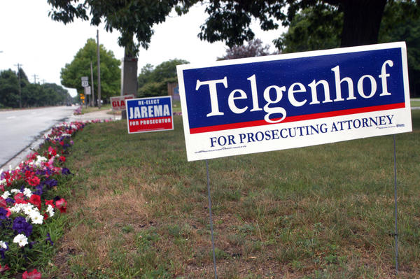 Political signs appear near an intersection in Charlevoix, including those for Charlevoix County prosecutor candidate Allen Telgenhof and incumbent two-term prosecutor John Jarema, both running in the Aug. 7 Republican primary election.