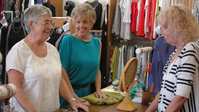 Pappagallo owner Joan Morford (middle) and manager Vicki Arnold (right) interact with long time customer Betty Adgate (left).