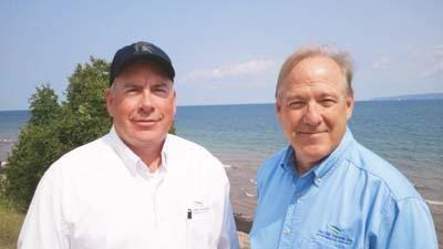 CMS Land Vice President Mike Sniegowski (left) and CMS Land Area Manager Tim Petrosky are pictured along Coastal Ridge Drive in Bay Harbor.