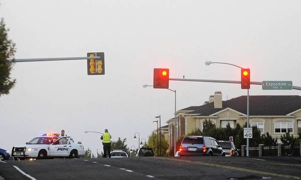 Photos: Shootings at Colorado theater: Law enforcement officials block roads near the Century 16 Theatre where a masked gunman killed more than 10 people at a midnight showing of the new Batman movie in Aurora, Colorado.