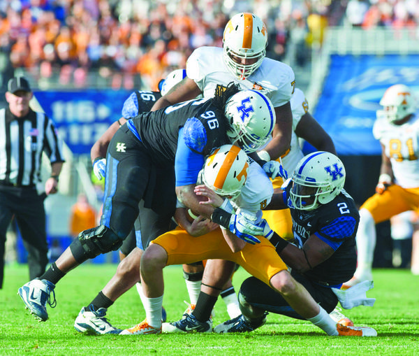 Kentucky defensive end Collins Ukwu (96) and linebacker Alvin Bud Dupree (2) sack Tennessee Volunteers quarterback Tyler Bray during last seasons win over the Volunteers. Kentucky coach Joker Phillips said snapping the long losing streak to tennessee gave his team a boost heading into the offseason.