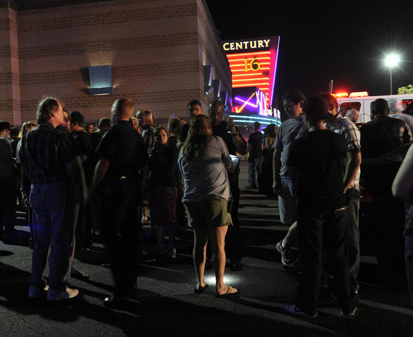 Police begin interviewing theater patrons outside the Century 16 early Friday morning.
