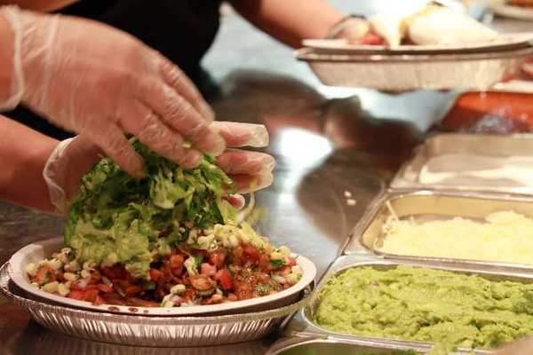 Final touches are added to a Burrito Bowl at a Chipotle restaurant in Chicago.