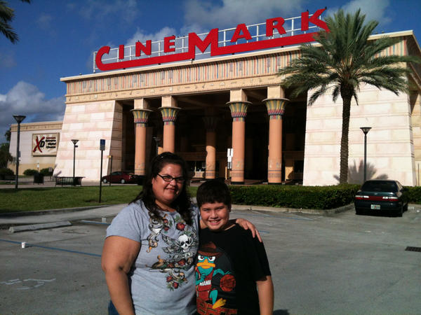 "Cynthia Colina, of Miami Lakes, with her son Joshua, 10, to see ""Dark Knight Rises,"" responded to news about the shooting by saying: ""Crime's gonna happen whether it's this or any movie."""