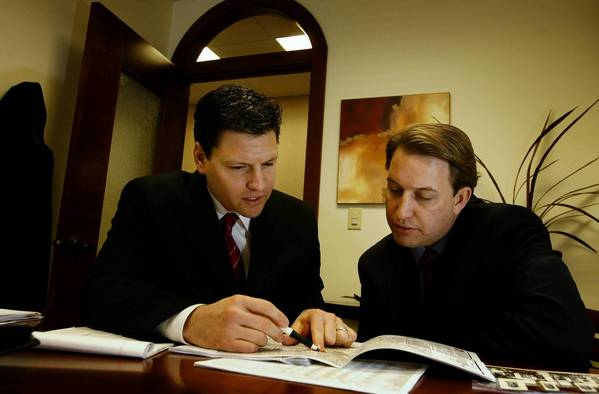Financial planner William Taylor, right, works with client Robert Elliott, president of Stillwater Capital Investments, at Elliott's office in Highland Park Village in Dallas, Texas, February 15, 2007.