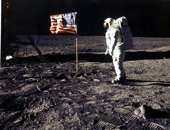 "Neil Armstrong and Buzz Aldrin (pictured) become the first humans to walk on the moon. Armstrong uttered one of the most famous phrases ever when he stepped onto the surface: ""That's one small step for man, one giant leap for mankind."" But perhaps the greatest phrase from the visit is printed on a plaque the two left on the surface of teh moon: ""Here men from the planet Earth first set foot on the moon--July 1969 A.D--We came in peace for all mankind."" Humans walked on the moon. But we have yet to conquer the common cold."