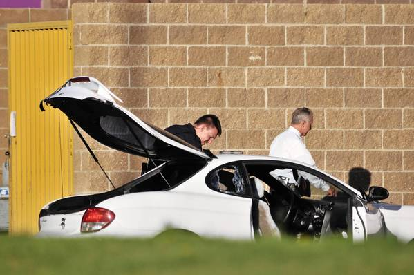 Photos: Shootings at Colorado theater: Police search what is believed to be the car of James Holmes, the suspect of a shooting in a movie theater, outside the Century 16 movie theater in Aurora, Colorado.