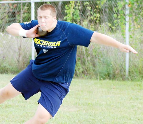 Tommy Roush of Petoskey practices the shot put Thursday at Curtis Field in in Petoskey. Roush, 14, will compete beginning Monday, July 23, in the Junior Olympics at Morgan State University in Baltimore.