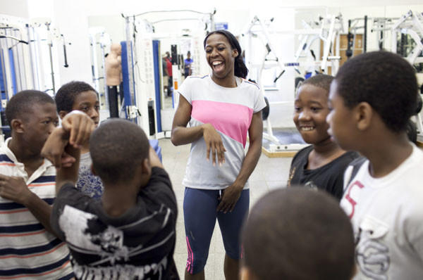 Francena McCorory shares smiles with boys, who visit Hampton University from North Phoebus Community Center, as she works on training at the university on Tuesday, July 10.