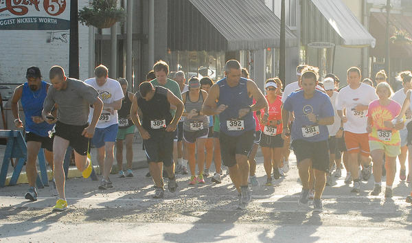 Runners begin the 5K Run for Independence Saturday morning.