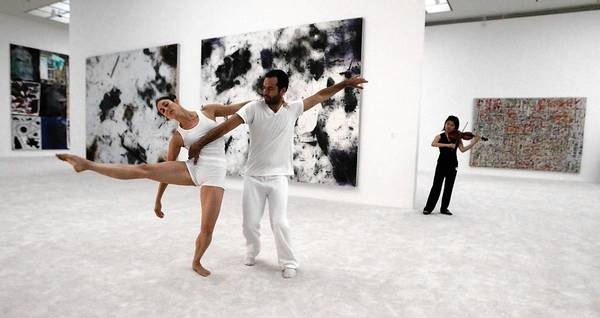Benjamin Millepied, center, performs with Amanda Wells and violinist Mayumi Kanagawa at MOCA.