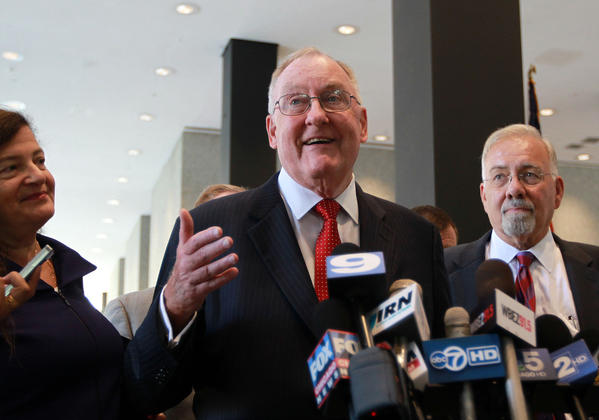 James R. Thompson, center, speaks to the media in the lobby of the Dirksen U.S. Courthouse in Chicago after arguments were made in the appeal of imprisoned former Governor George Ryan. DePaul Professor Andrea Lyon is at left. University of Chicago Professor Emeritus Albert Alschuler is at right.