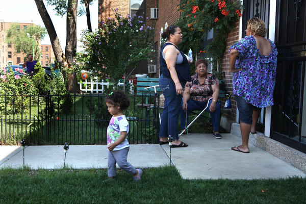 Residents and their friends at Lathrop Homes in Chicago gather outside to socialize. Residents of a Northwest Side public housing complex said today they want the Chicago Housing Authority to guarantee they can continue living in their homes during a future redevelopment project.