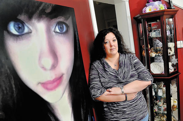 Wendy Crossland of Hagerstown stands in front of a photo of her late daughter, Anais Fournier, who died in December 2011 due to caffeine toxicity. Crossland is trying to get the U.S. Food and Drug Administration to recognize energy drinks as beverages instead of a dietary supplement.