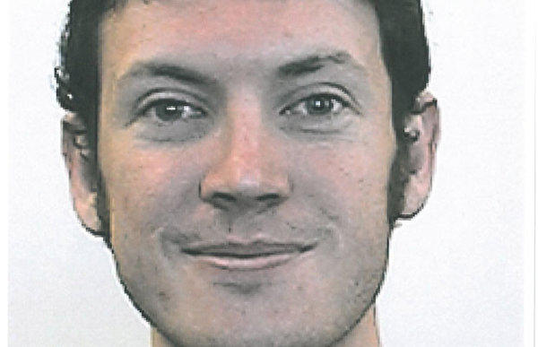 Suspected gunman James Holmes had his hair painted red and called himself the Joker, authorities said.