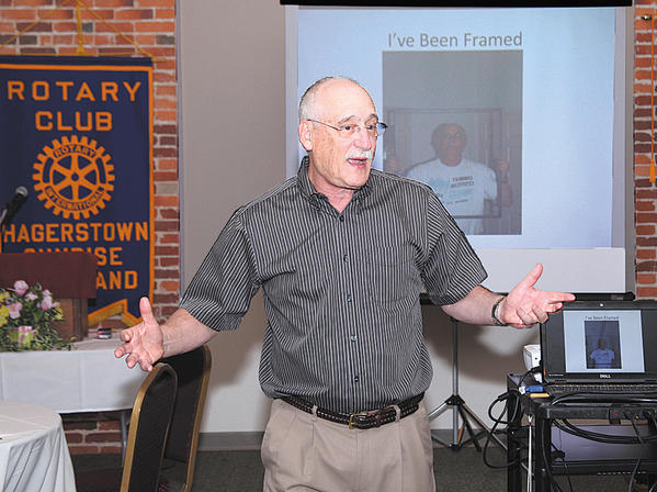 Dr. Ira Lourie, a local physician and photographer, was the featured guest speaker at the Sunrise Rotary meeting at Academy Theater on July 13.