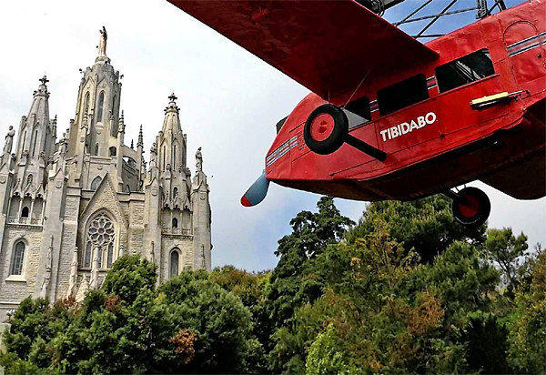 Tibidabo amusement park with the Church of the Sacred Heart beyond.