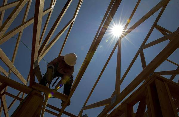 "A laborer works on a new home in Dublin, Calif. ""Construction was our biggest major drag for a long time,"" said economist Esmael Adibi. ""But now we're coming back stronger in terms of percentages."""