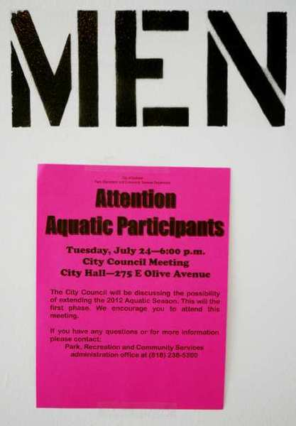 A poster on the way into the men's locker room alerting aquatic participants of a Burbank City Council discussion to extend the 2012 aquatic season at the McCambridge Swimming Pool in Burbank.