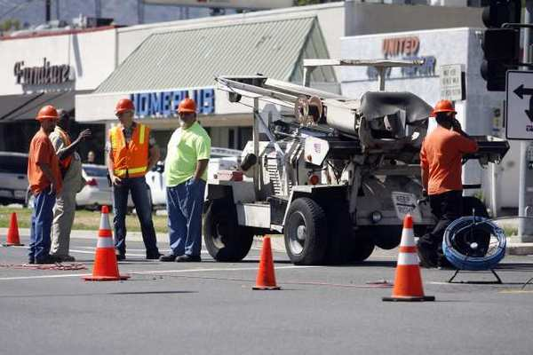 Workers close off a four-foot sinkhole on Grandview Avenue and Glenoaks Boulevard in Glendale.