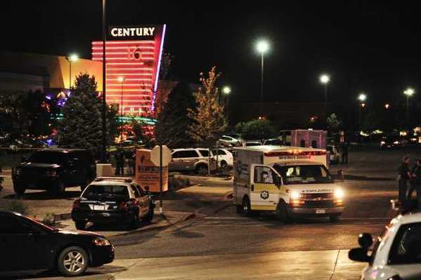 An ambulance waits outside the Century 16 cineplex in Aurora, Colo., in the aftermath of the shooting rampage there early Friday.