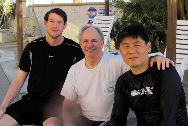 From left, Jonathan Oskins, Brian Cohee and Yong Hwan Kim. Cohee, 58, of Claremont died Thursday while surfing off West Newport. He was studying at the Claremont School of Theology to be a minister.