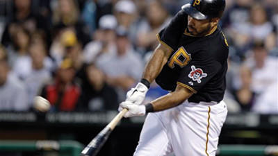 Pittsburgh Pirates' Pedro Alvarez hits a solo home run off Miami Marlins pitcher Ricky Nolasco during the fourth inning of a baseball game in Pittsburgh Friday.