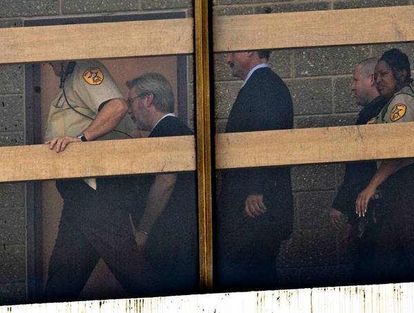 Drew Peterson is escorted to a courtroom at the Will County Courthouse for a final status hearing on Wednesday.