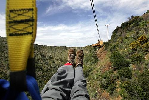 As part of its effort to enhance Santa Catalina Island as a tourist destination, the Santa Catalina Island Co. has created a 3,671-foot-long zipline ride. After designer Bradd Morse inspected and tested the line, Times photographer Bob Chamberlin tried out the first leg of the attraction. The company hopes to open the zipline to the public April 14.