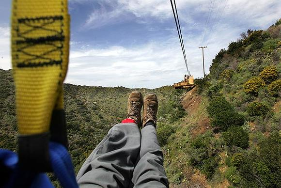 As part of its effort to enhance Santa Catalina Island as a tourist destination, the Santa Catalina Island Co. has created a 3,671-foot-long zipline ride. After designer Bradd Morse inspected and tested the line, Times photographer Bob Chamberlin tried out the first leg of the attraction. The company