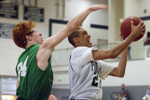 Providence's Christian Ware-Berry does a layup and is fouled by Reedley's Clay Kosinski during a game at Providence High School in Burbank on Saturday, July 21, 2012.