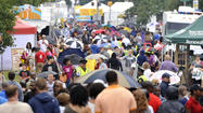 Undeterred by the wet weather, thousands strolled Saturday among the art displays, the crafts tables and the Italian sausage vendors of Artscape.