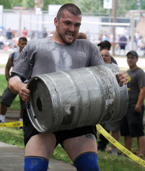 Dan Clingenpeel of Richmond, Virginia, competes in the keg carry during SportsFest on Saturday at Cedar Beach in Allentown.