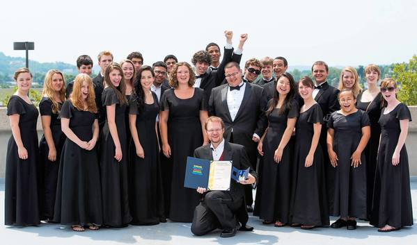 Director David Macbeth and LVP Touring Choir show off their gold medal.