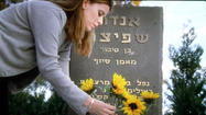 Anouk Spitzer places flowers at the grave of her father, Andrei, among 11 Israelis killed in the 1972 Munich Olympic massacre. (Sony Classics Pictures)