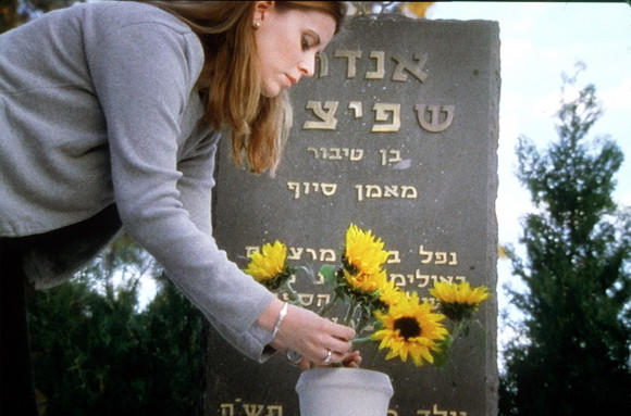 Anouk Spitzer places flowers at the grave of her father, Andrei, among 11 Israelis killed in the 1972 Munich Olympic massacre.