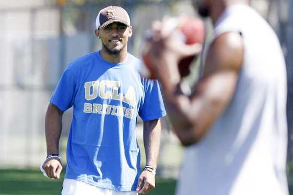 UCLA and former St. Francis football player Dietrich Riley runs through a demonstration during the NCAA Football Youth Skills Clinic, which took place at the Jackie Robinson Park in Pasadena on Saturday.