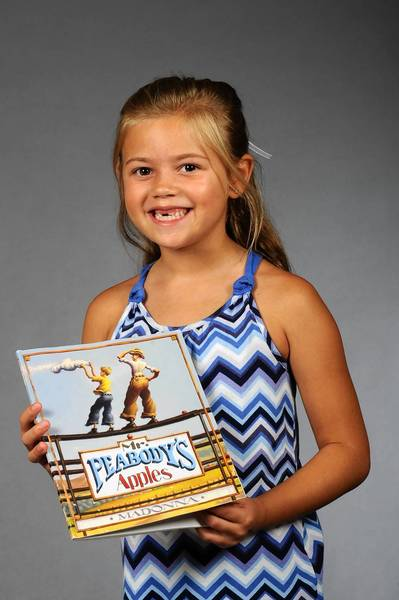 "Jazmine Gibbons of Bethlehem Township with her favorite book, ""Mr. Peabody's Apples"" by Madonna."