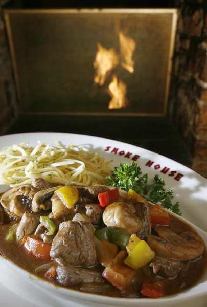 Steak Sinatra, of tenderloin chunks in a stew-like broth with mushrooms and vegetables, served with pasta at SmokeHouse in Burbank.